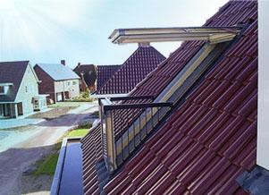 dakraam amsterdam met balkon schuin dak